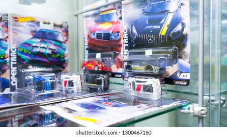 KUALA LUMPUR, MALAYSIA - JANUARY 2019: Hotwheels diecast toys logo on display glass shelf. Hotwheels is a product of Mattel, with factories located in Penang, Malaysia and Thailand.