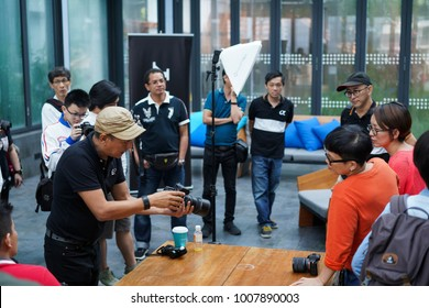 Kuala Lumpur, Malaysia - January 21, 2018 : A group of photographer student on photography shooting workshop course held in a hotel indoor at Kuala Lumpur, Malaysia.