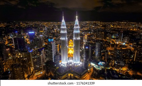 Kuala Lumpur, Malaysia. January 22, 2018. Aerial night view of KLCC or Petronas Towers, also known as the Petronas Twin Towers are twin skyscrapers in Kuala Lumpur. soft and grain effect.