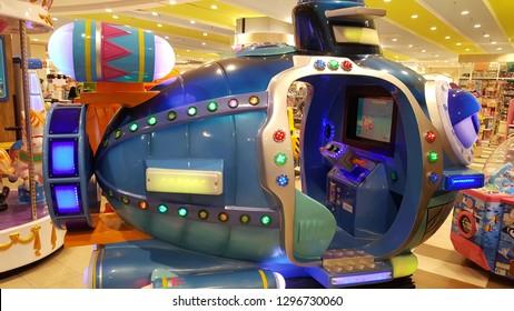 Kuala Lumpur / Malaysia - January 25 2019:  Kids' helicopter ride arcade game