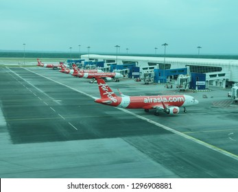 Kuala Lumpur, Malaysia - January 25, 2019 : Kuala Lumpur International Airport Terminal 2 or KLIA2 view from Departure gate. See Airasia plane taxing and parking at the dock.
