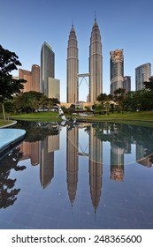 Kuala Lumpur, Malaysia  January 25 2015: The Petronas twin towers get reflected at still pool outside of Kuala Lumpur City Center (KLCC).