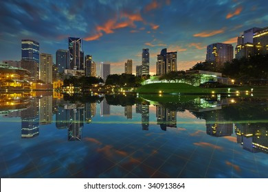 Kuala Lumpur, Malaysia January 25 2015: Some newly developed buildings get reflected at still pool outside of Kuala Lumpur City Center (KLCC).