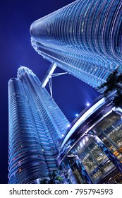 Kuala Lumpur, Malaysia - January 26, 2014: Petronas Twin Towers at night from under the building view.