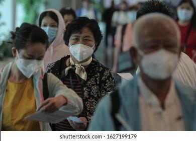 KUALA LUMPUR , MALAYSIA - JANUARY 27,2020. Tourists wearing the mask at the airport as precautionary measures during coronavirus from Wuhan ,China