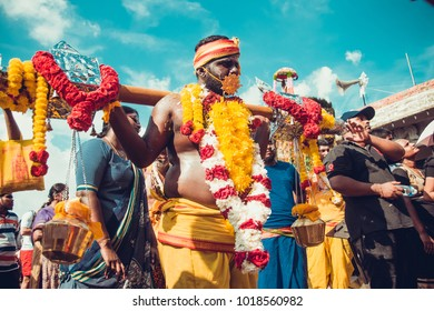 KUALA LUMPUR, MALAYSIA - JANUARY 31 2018: Hindu devotees celebrate Thaipusam festival with procession and offerings. People portrait. Man with kavadi milk pots