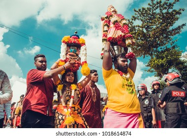 KUALA LUMPUR, MALAYSIA - JANUARY 31 2018: Hindu devotees in the procession in honor of the celebration Thaipusam festival carry milk pots kavadi
