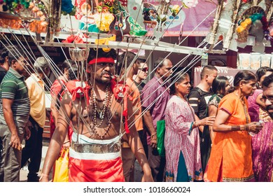 KUALA LUMPUR, MALAYSIA - JANUARY 31, 2018:  Piercing man takes part in the  procession hindu devotees celebrate Thaipusam festival with offerings.  Culture and traditions.