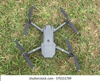 Kuala Lumpur, Malaysia - January 31, 2017: Close up photo of DJI Mavic Pro with green grass background. Mavic Pro is the latest drone product of DJI featuring its compact and foldable design.
