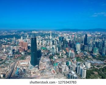 KUALA LUMPUR, MALAYSIA - January 5,  2019: Beautiful and dramatic aerial view of Kuala Lumpur city with new skyscraper under construction in Tun Razak Exchange.