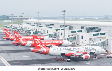Kuala Lumpur, Malaysia - January 5, 2015. Aircraft of Air asia are parking and preparing to flying at Kuala Lumpur International Airport on Jan 5, 2015