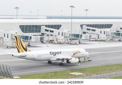 Kuala Lumpur, Malaysia - January 5, 2015. Aircraft of Tiger airway preparing to take off at Kuala Lumpur International Airport on Jan 5, 2015