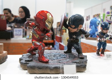 KUALA LUMPUR, MALAYSIA -JANUARY 6, 2019: Selected focused on  Iron Man and Captain America character action figure fighting each other from Marvel Iron Man comics and movies.