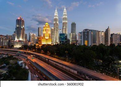 KUALA LUMPUR, MALAYSIA -  JANUARY 9, 2016: Evening view on on the cityscape around the Petronas Twin Towers. The most popular tourist destination in Malaysian capital