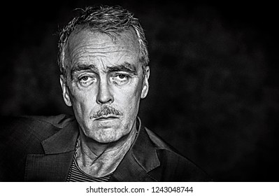 KUALA LUMPUR, MALAYSIA : JULAI 2, 2018 - Black and white portraiture photo of John Hannah, one of actor in The Mist in Evening movie at Kuala Lumpur. Noise concept for B&W and soft focus.