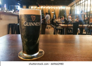 Kuala Lumpur, Malaysia, July 1, 2017:  Guinness is an Irish dry stout that originated in the brewery of Arthur Guinness at St. James's Gate brewery, Dublin, Ireland. Leading black stout in Malaysia