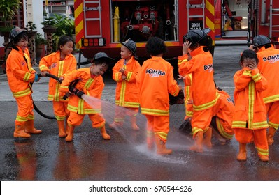 """Kuala Lumpur, Malaysia - July 1, 2017 : Kids from pre-school attending fire fighting course. The """"Bomba Cilik"""" is a sosial programe initiated by Malaysia Fire Department or Jabatan Bomba."""