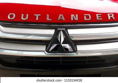 Kuala Lumpur, Malaysia- July 10, 2018 : close up view of Mitsubishi car logo. It is historically descended from the Mitsubishi zaibatsu, a unified company which existed from 1870.