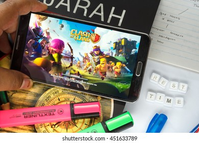 KUALA LUMPUR, MALAYSIA - JULY 13, 2016 : An Android user plays Clash of Clans, after study 2 hour, a free-to-play augmented reality mobile game developed by Supercell Ltd. for iOS and Android devices.