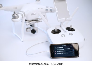 KUALA LUMPUR, MALAYSIA - JULY 13, 2017: DJI provides firmware updates for users to enjoy the latest added features. Selective focusing on smartphone display showing firmware update process.
