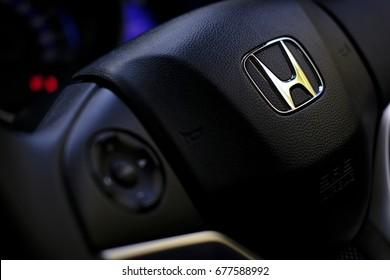Kuala Lumpur, Malaysia - July 15, 2017 : Honda Black Steering Wheel And Silver Logo. Honda Motor Co., Ltd. is a Japanese public multinational conglomerate corporation.