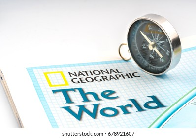 KUALA LUMPUR, MALAYSIA - JULY 15, 2017: National Geographic map and compass with travelling conceptual.
