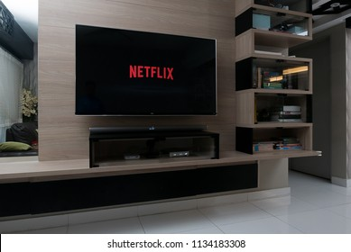 KUALA LUMPUR, MALAYSIA - JULY 15TH, 2018 : Modern lifestyle with LG Android TV to stay connected & browsing media using favourite Apps. Tv display Netflix app.