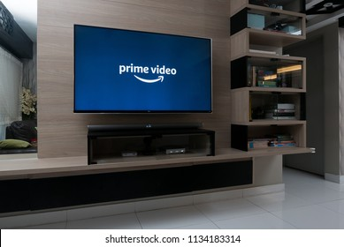 KUALA LUMPUR, MALAYSIA - JULY 15TH, 2018 : Modern lifestyle with LG Android TV to stay connected & browsing media using favourite Apps. Tv display Amazon Prime Video app.