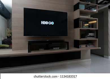 KUALA LUMPUR, MALAYSIA - JULY 15TH, 2018 : Modern lifestyle with LG Android TV to stay connected & browsing media using favourite Apps. Tv display HBO Go app.