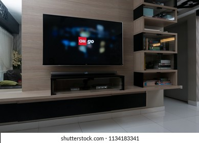 KUALA LUMPUR, MALAYSIA - JULY 15TH, 2018 : Modern lifestyle with LG Android TV to stay connected & browsing media using favourite Apps. Tv display CNN Go app.