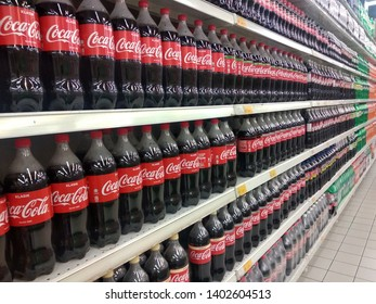KUALA LUMPUR, MALAYSIA -JULY 16, 2018: COKE-COLA drinks in large bottles are displayed on a shelf for sale in a large supermarket. Placed in large quantities based on high demand.