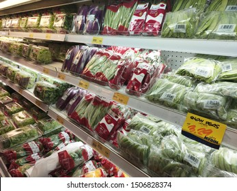 KUALA LUMPUR, MALAYSIA - JULY 16, 2019: Vegetables packed inside plastic container and plastic wrap. Displayed on the cool chiller rack inside the supermarket.