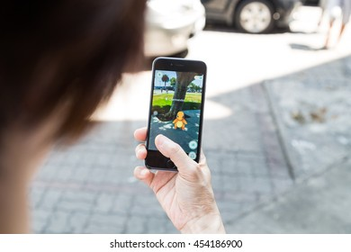KUALA LUMPUR, MALAYSIA, JULY 16, 2016: An IOS user plays Pokemon Go, a free-to-play augmented reality mobile game developed by Niantic for iOS and Android devices.