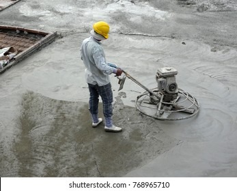 KUALA LUMPUR, MALAYSIA -JULY 16, 2017: Power float works by construction workers at the construction site. Power float machine was used to level wet concrete.