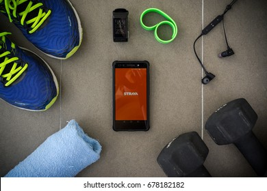 KUALA LUMPUR, MALAYSIA - JULY 16TH, 2017 : Modern lifestyle with smartphone to stay fit using favourite Fitness Apps STRAVA. connect millions of runners and cyclists through the sports they love.