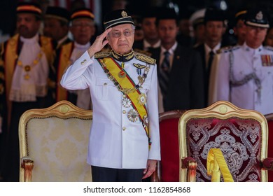 KUALA LUMPUR, MALAYSIA - JULY 17, 2018. The seventh Prime Minister of Malaysia, Mahathir Mohamad give salute as he arrives during the opening ceremony of Parliament session in Kuala Lumpur.
