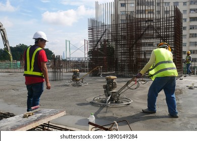 KUALA LUMPUR, MALAYSIA -JULY 17, 2020: Power float works by construction workers at the construction site. Power float machine was used to level wet concrete.