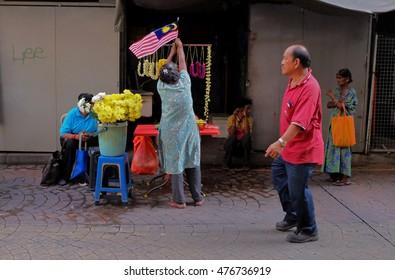 Kuala Lumpur, Malaysia July 17, 2016 : Street side flower sellers at Petaling Street, Kuala Lumpur.