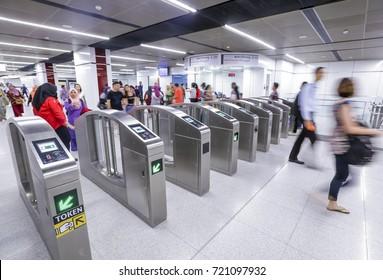 KUALA LUMPUR, MALAYSIA : JULY 17, 2017 : Passenger at entrance gate of Bukit Bintang Mass Rapid Transit (MRT) stations. MRT alleviate the severe traffic congestion in the KL metropolitan area.