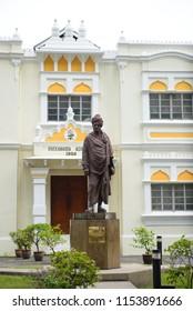 Kuala Lumpur, Malaysia - July 18, 2018 : Vivekananda Ashram building, with the bronze statue of Swami Vivekananda, one of the official heritage iconic status in Brickfields street