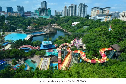 KUALA LUMPUR, MALAYSIA - JULY 18, 2019 : View of Sunway Lagoon theme park with Sunway Resort Hotel and Sunway Pyramid mall, built and owned by the Sunway group.