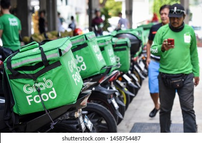 """Kuala Lumpur, Malaysia - July 18, 2019 : """"GRAB FOOD"""" MOTORBIKE at the street. Food delivery service through its app."""