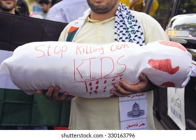 KUALA LUMPUR, MALAYSIA - JULY 18 2014: Unidentified Palestinian and Malaysian people are marching and demonstrating against Zionist Israel in front of US America Embassy in Kuala Lumpur, Malaysia.