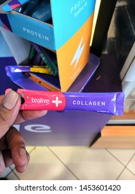 Kuala Lumpur, Malaysia - July 2019 : Closeup hand holding Tealive collagen pack. Tealive is a Taiwanese global franchise teahouse chain based in Taiwan.