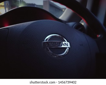Kuala Lumpur, Malaysia - July 2019 : Closeup view of NISSAN emblem on steering inside car. Nissan is japanese automobile manufacturers.
