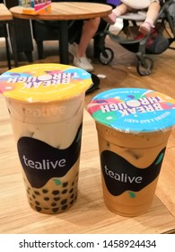 Kuala Lumpur, Malaysia - July 2019 : Tealive pearl milk tea and  ice coffee on the table. Tealive is a Taiwanese global franchise teahouse chain based in Taiwan.
