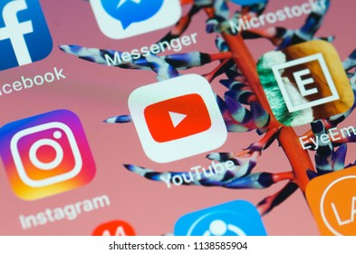 Kuala Lumpur, Malaysia, July 20,2018; Close-up to Youtube video sharing community app on the screen of an iPhone 7 plus with personalized background.