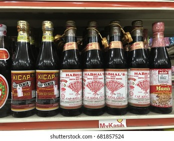 Kuala Lumpur, Malaysia - July 21st, 2017. Cap Tamin, Cap Kipas Merah and Adabi are the brand name of famous sweet soy bean ketchup on shelf in supermarket