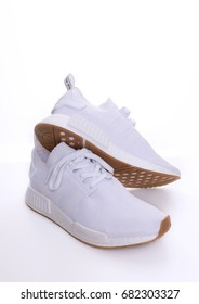Kuala Lumpur, Malaysia - July 23, 2017:   Picture of Adidas Original NMD R1 Gum Pack All White on white background.