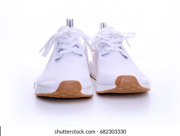 Kuala Lumpur, Malaysia - July 23, 2017: Front view of Adidas Original NMD R1 Gum Pack All White on white background.